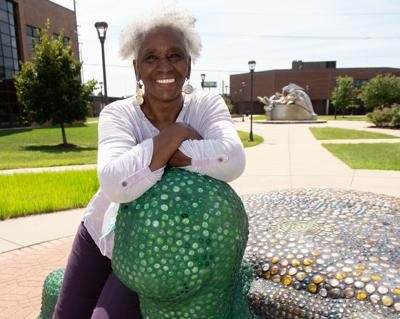 """Artist Edna Patterson-Petty with """"Monty, The Turtle"""""""