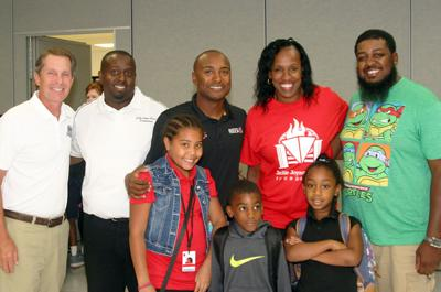 WWTR owner and CEO Curtis Francois (left) during a visit to the Jackie Joyner-Kersee Center with three-time NHRA champion Antron Brown