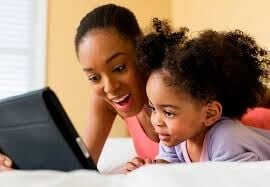 Mother and daughter at laptop