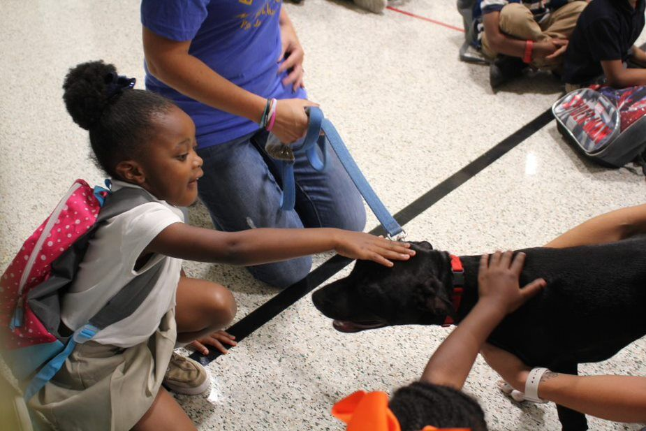 Hodgen Tech Students with puppy