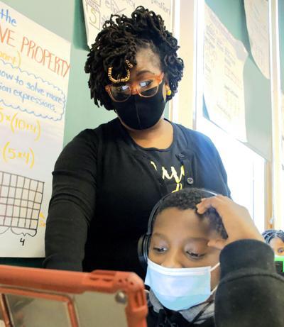 St. Louis Public Schools teacher Audrey Hammock works with Walter Foster
