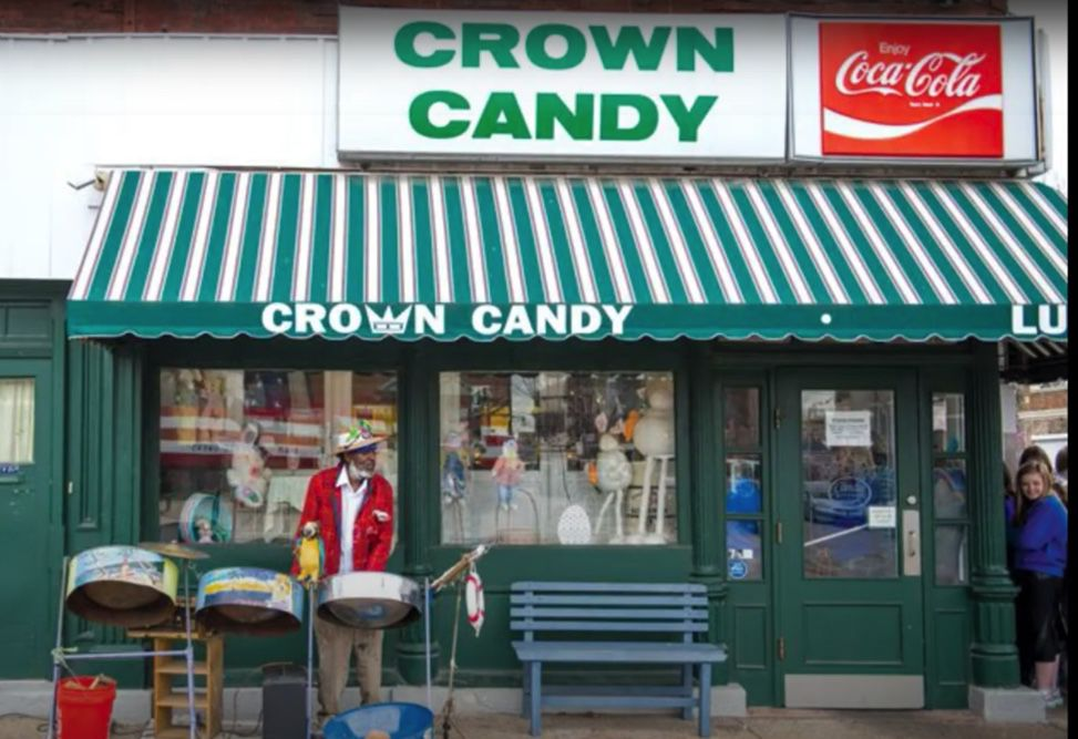 Jamaica Ray with drums outside Crown Candy