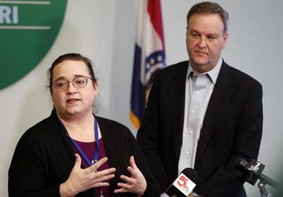 St. Louis County Health Department co-director Spring Schmidt (left) and St. Louis County Executive Sam Page