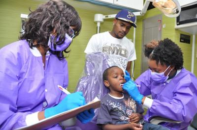 89c72d263 Kid s bus visit takes anxiety out of dental care
