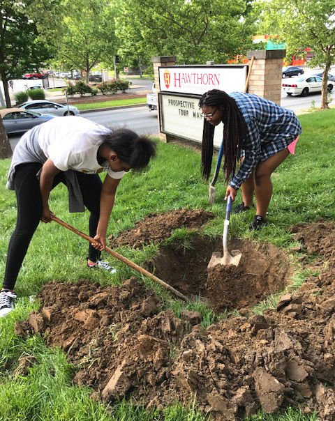 Carlia Idleburg and Jayla Gordon-Spraggins plant trees