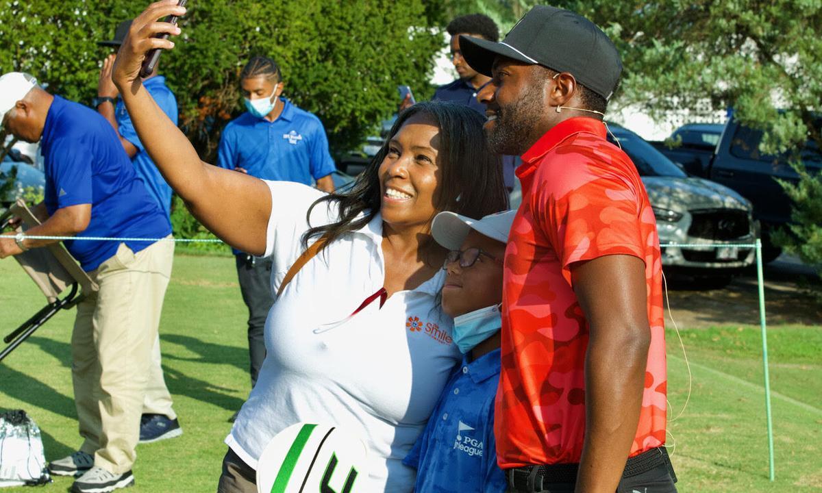 Jannis Williams and her grandson Mekhi Robenson with PGA pro golfer Christian Heavens