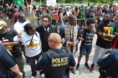 Cornell West and clergy protest