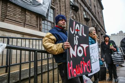 Activists and homeless St. Louisans protest outside of New Life Evangelistic Center