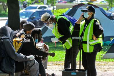 Homeless residents and city workers