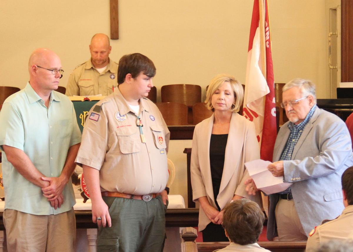 Hayden Miller hears his Eagle Charge during Court of Honor