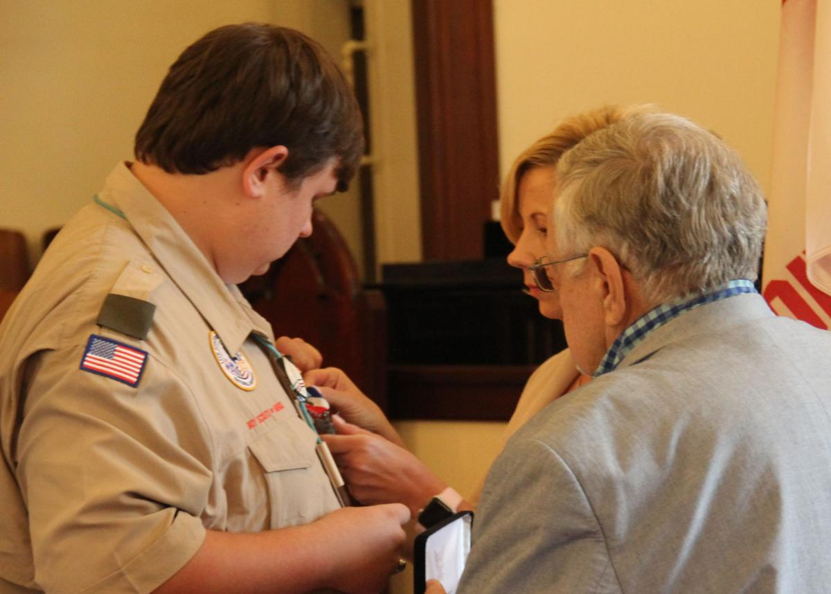 Hayden Miller receives his Eagle Scout badge