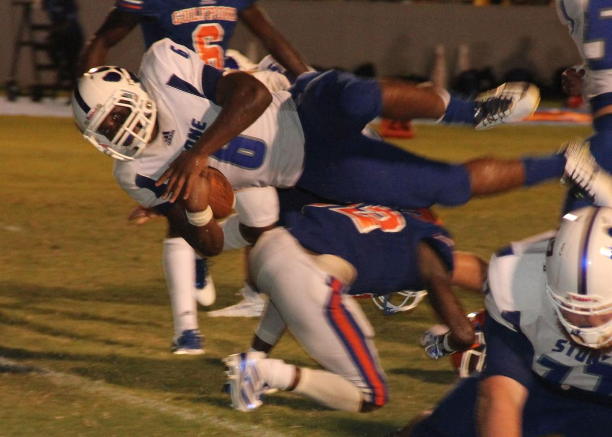 Carlos Brown vaults a Gulfport defender and goal line
