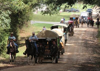 Wagon train approaches Stone County Fairgrounds