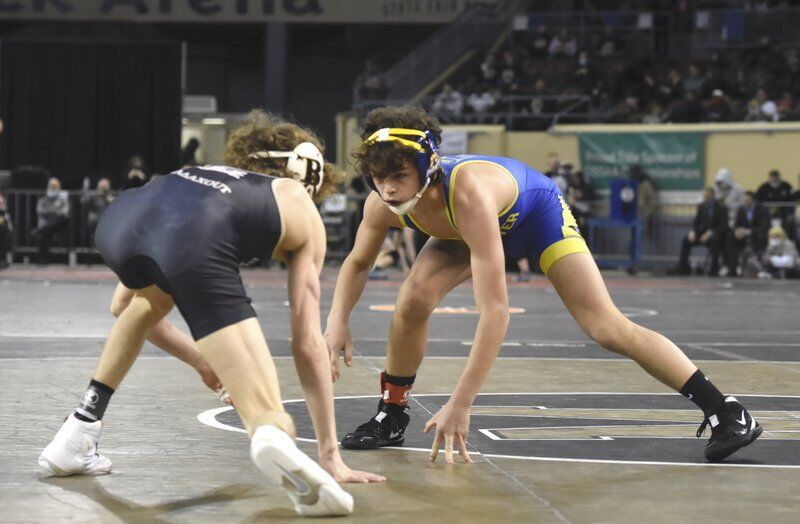 Lessons learned: Cowboy wrestling coach taking different approach to recruiting second son