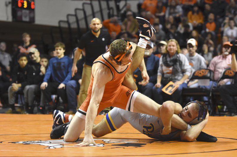 Cowboys get pair of upsets in lopsided victory over No. 10 Pitt