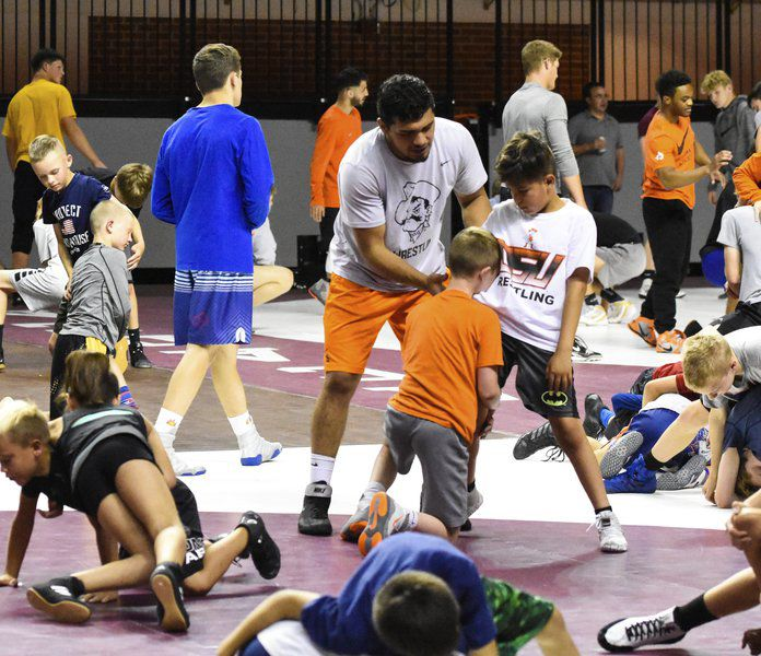 Cowboy camp growing sport of wrestling with youth, females