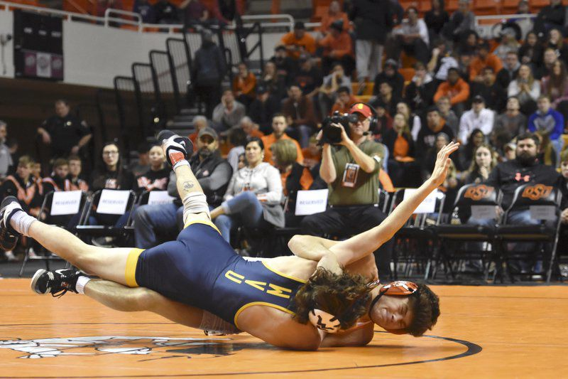Cowboy wrestling cruises to 37-9 blowout of West Virginia