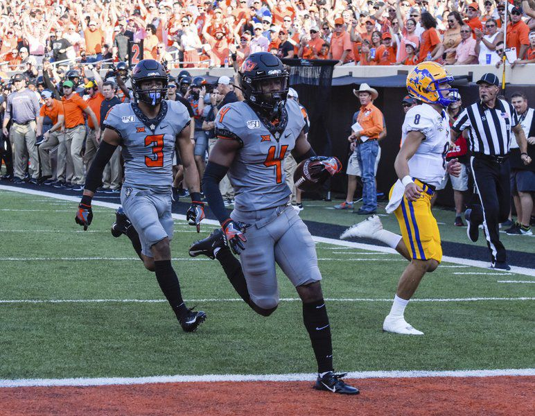 Green's pick six propels Oklahoma State to victory in home opener