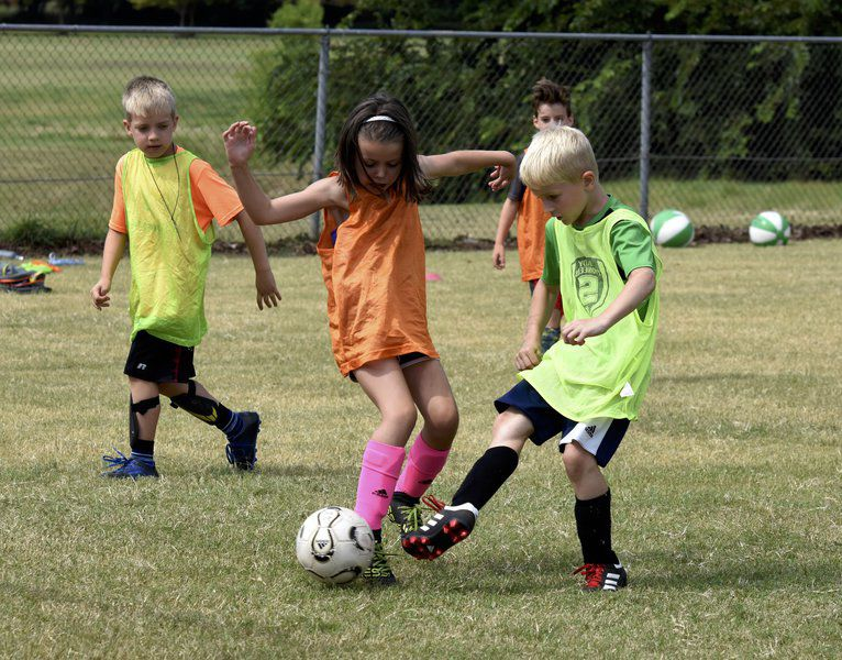 Pioneer Soccer Academy teaching coaching lessons during annual camp