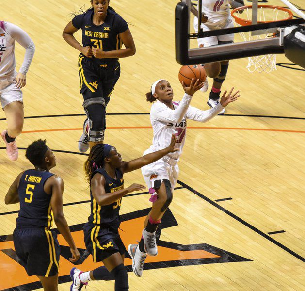Cowgirls peak at the end, top Mountaineers