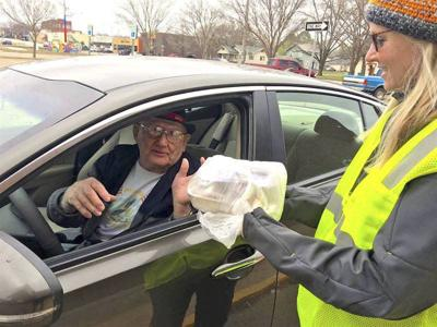 Taking it to go: Senior citizens adapt to curbside service at Project Heart