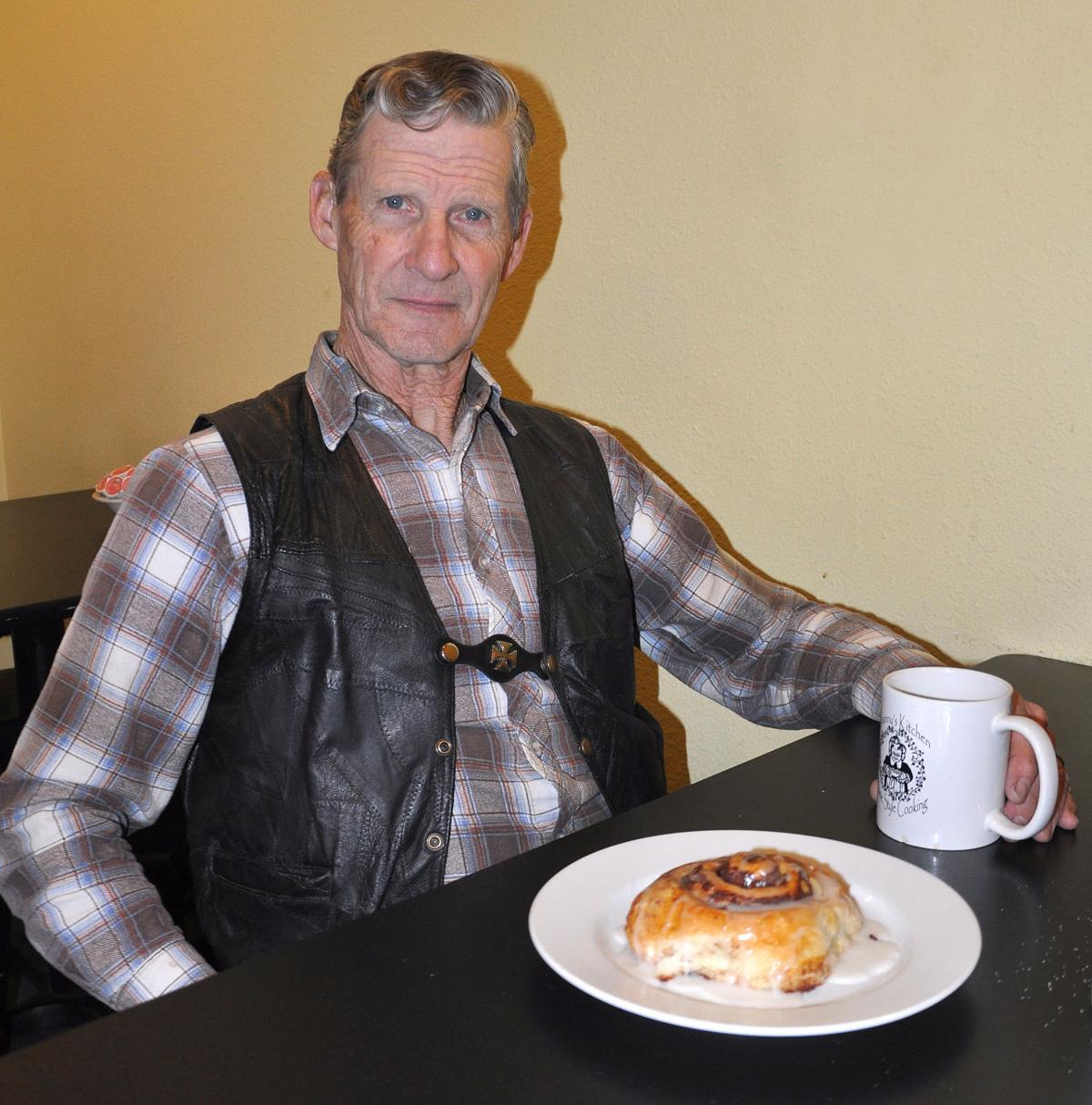 1118 Granny's Kitchen original family son with cinnamon roll.jpg