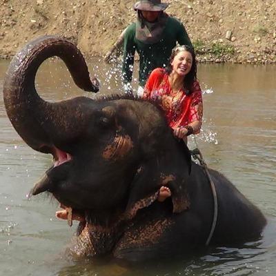 NewsPress Ben Ferchau Scholarship recipient DeEtta Cravens on elephant.jpg