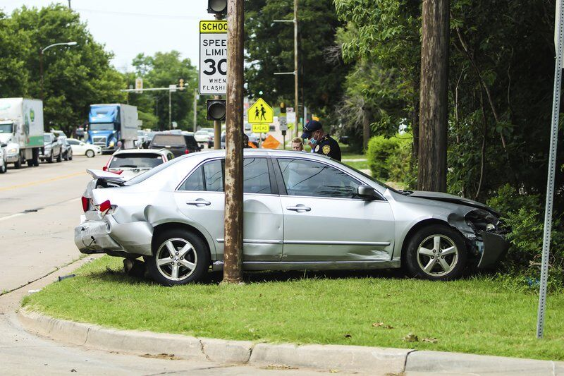 At least one injured in three-vehicle wreck