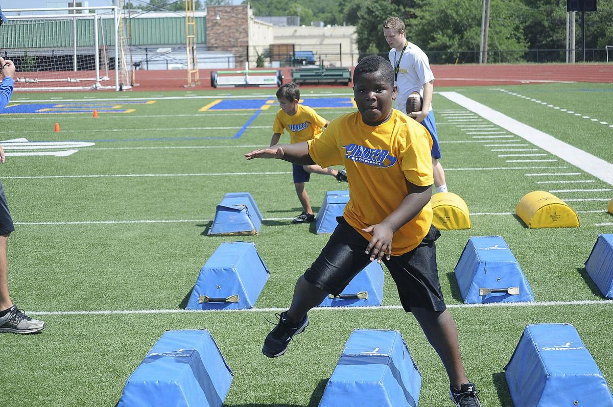 Football camp closes with flash of improvements | Local Sports