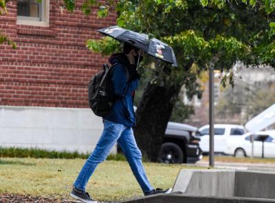 OSU student with umbrella