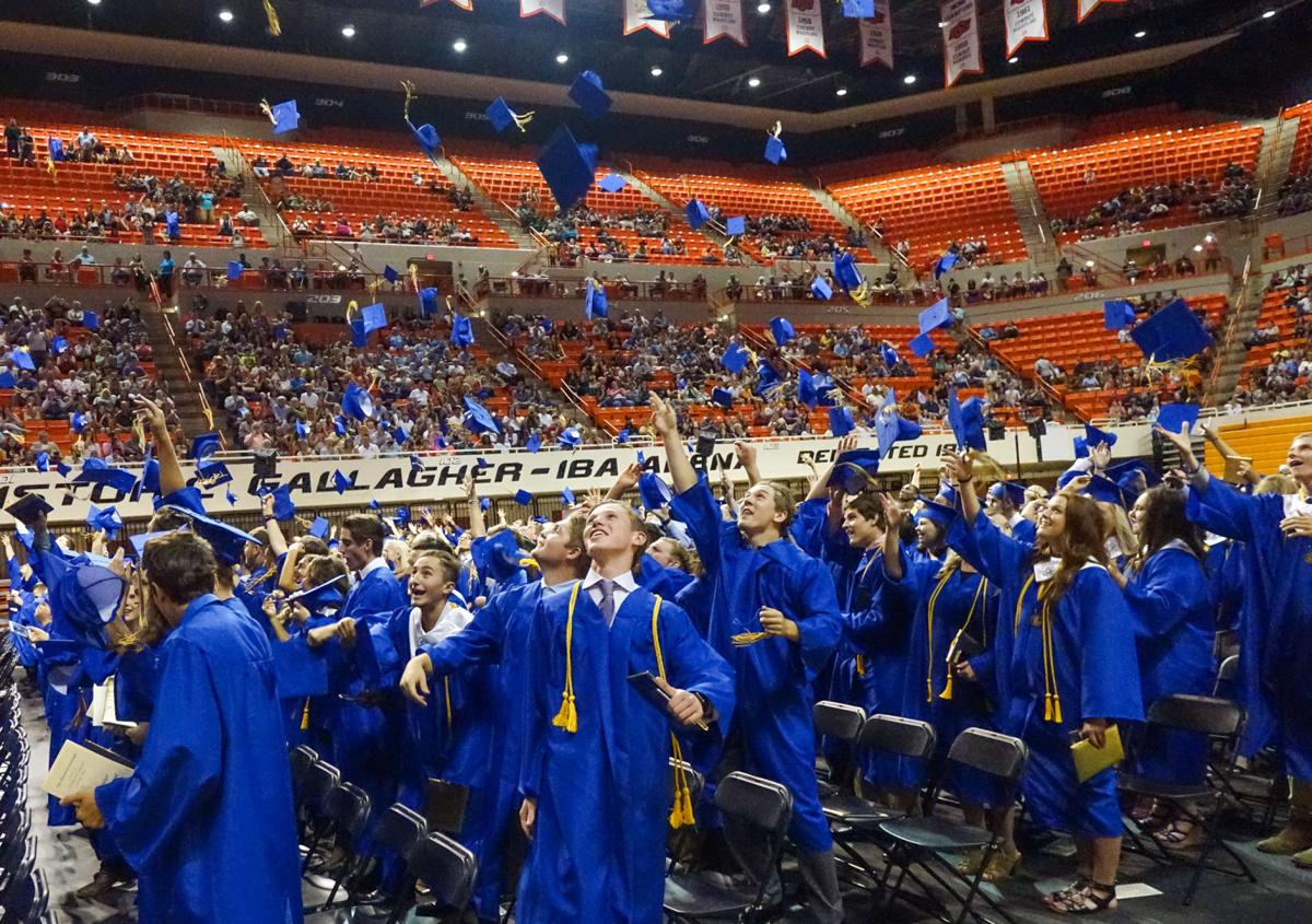 David Bitton/Stillwater News Press Stillwater High seniors celebrate  graduating by throwing their caps into the air Friday, May 26, 2017 at  Gallagher-Iba ...