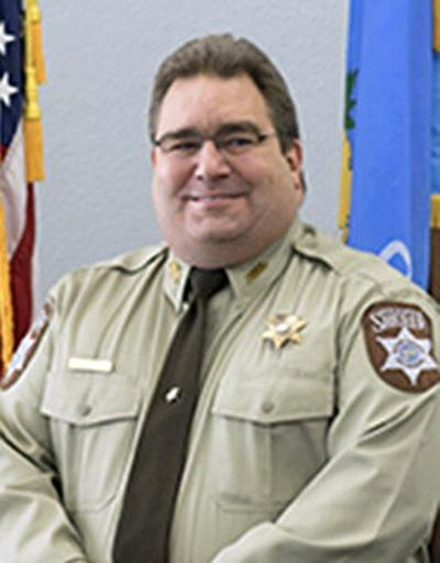 Commissioners retain sheriff after residency dispute
