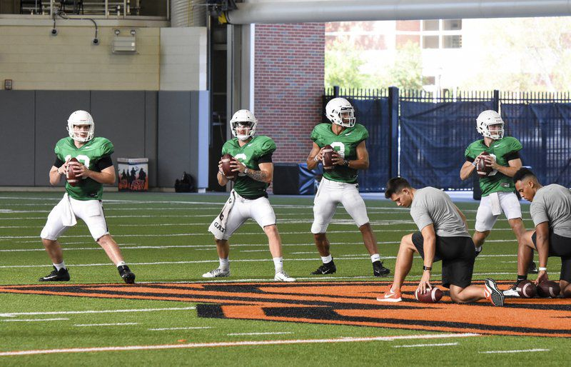 Coaches push Pokes with rising temperatures in fall camp