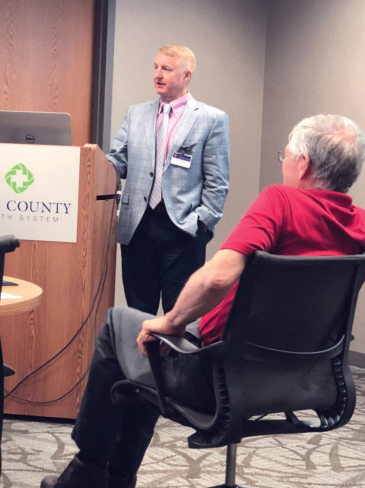 Brett Altman speaks to the board
