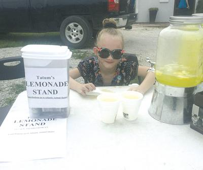 Tatum May and her lemonade stand