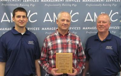 Jensen receives AMVC swine production achievement award