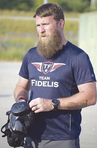 Masked man takes on personal challenge to run across state, raise awareness on veterans issue