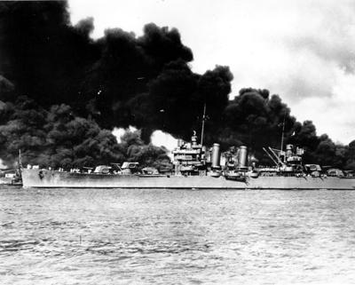 The USS Arizona burns at Pearl Harbor