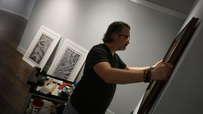 Leslie Powell prepares reception for new exhibit