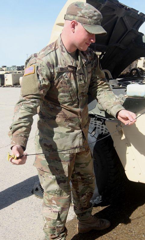 Sgt. Baker checking a dipstick