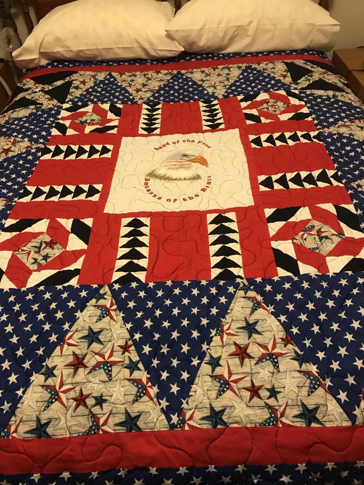 Donald Henke proudly displays his Quilt of Valor