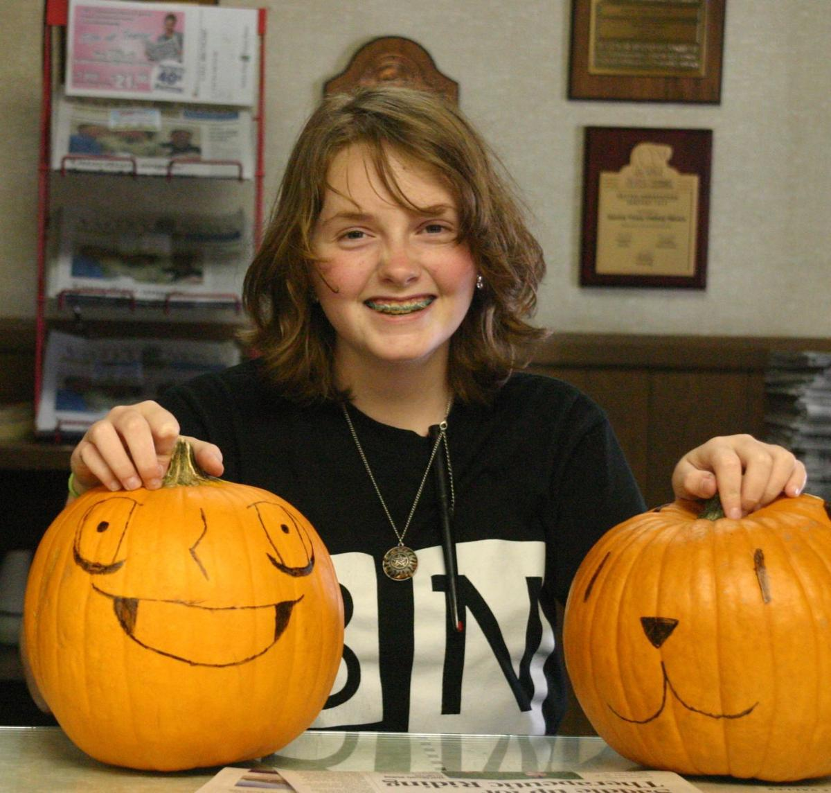 Layla Baker with decorated pumpkins