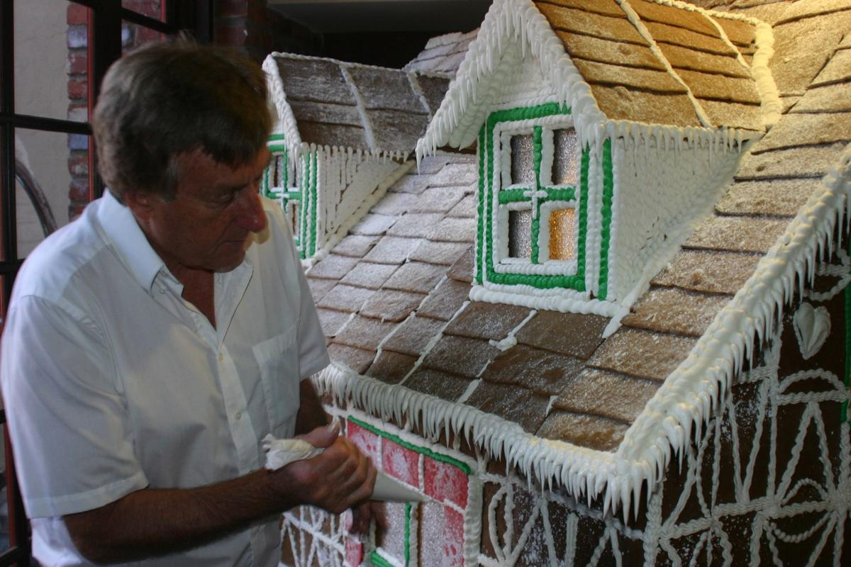 Olsen touches up gingerbread house