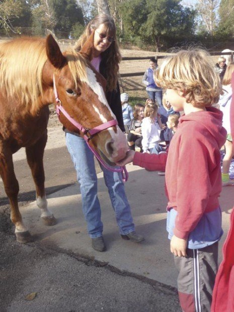 Third-graders learn how to care for animals