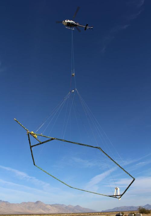SkyTEM helicopter takes off for survey