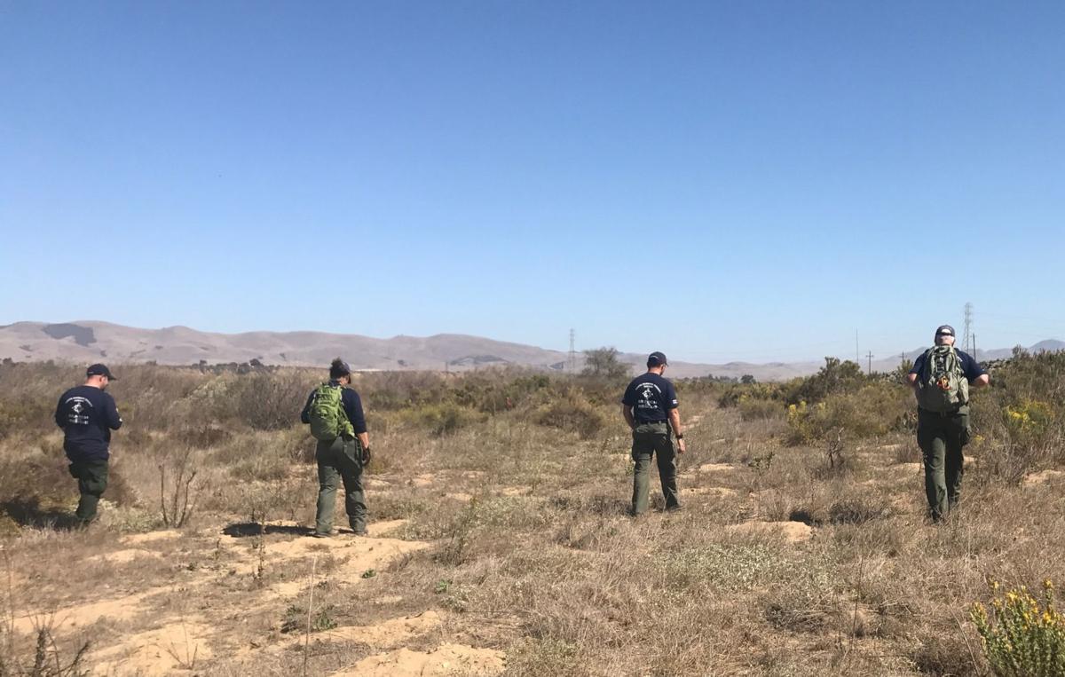 Santa Barbara County Sheriff's deputies search riverbed