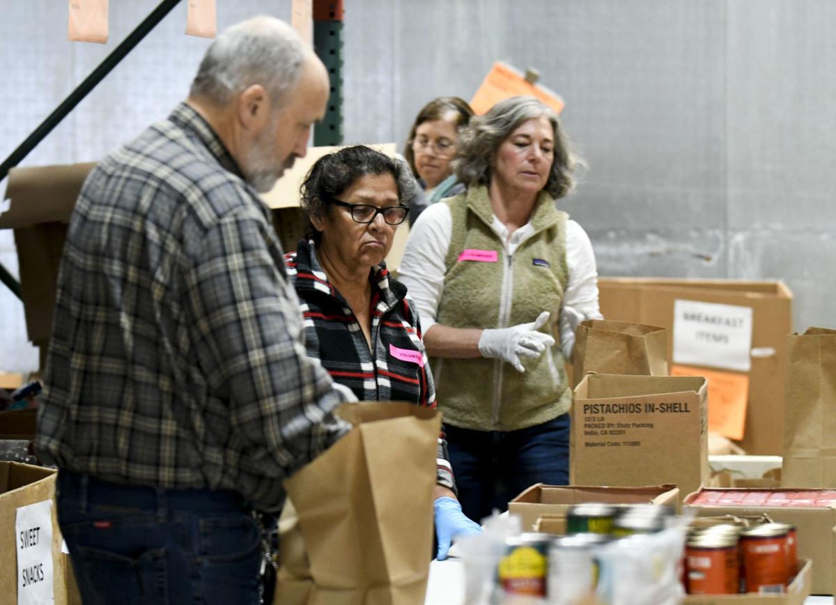 Foodbank volunteers pack for distribution