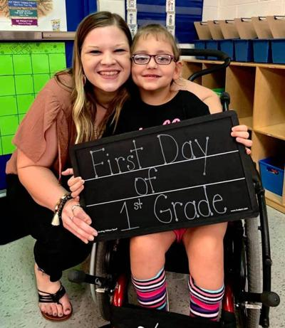 Teacher works one-on-one with special-needs kids