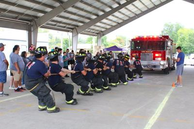 Teams pull fire truck to raise Relay for Life funds