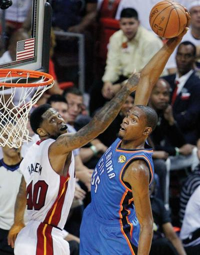 e519a3e1433 ... ready to throw down a slam dunk over Miami s Udonis Haslem in the first  half of Game 5. Durant finished with 32 points in the Thunder s 121-106  loss.